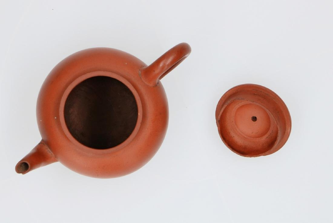 A Yixing teapot. Marked with 2-character mark Shi - 5
