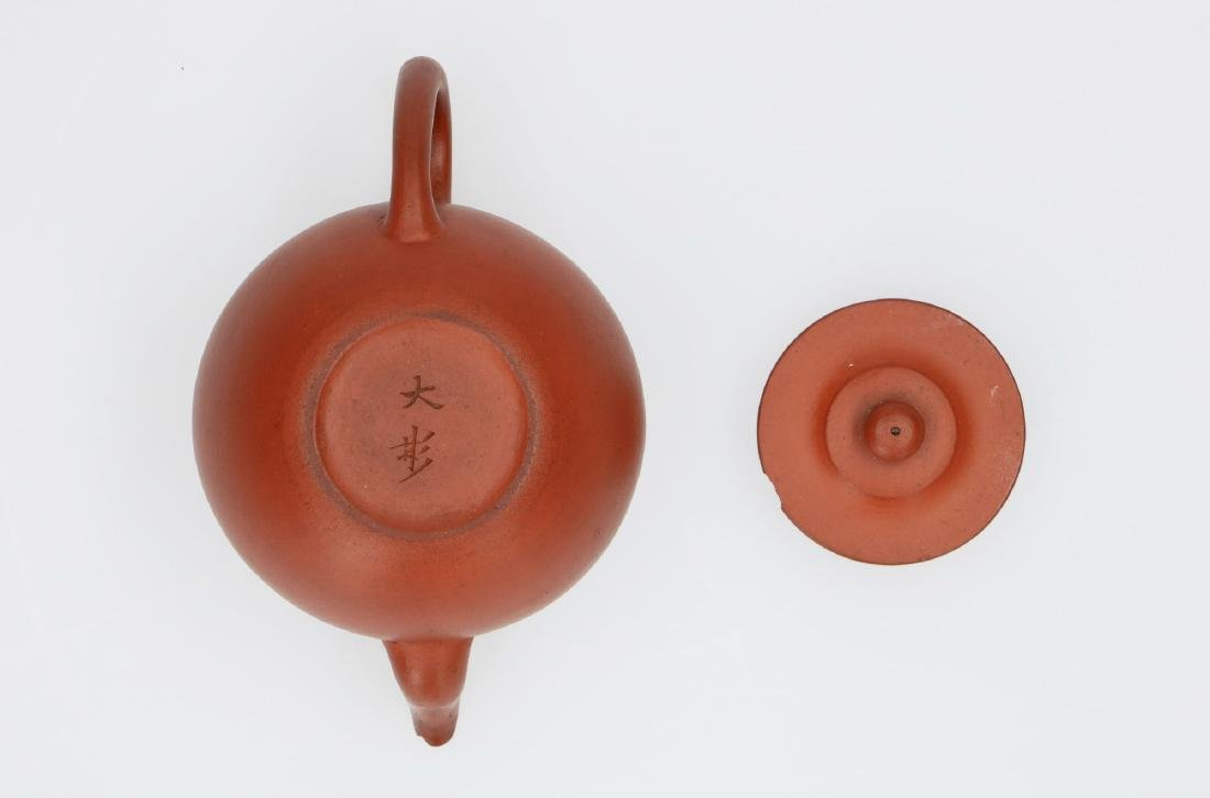 A Yixing teapot. Marked with 2-character mark Shi - 6