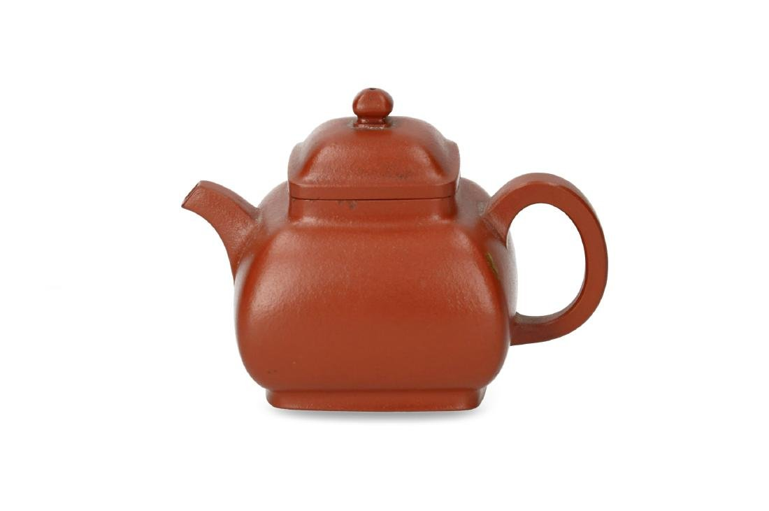 A square-shaped Yixing teapot. Marked with 7-character