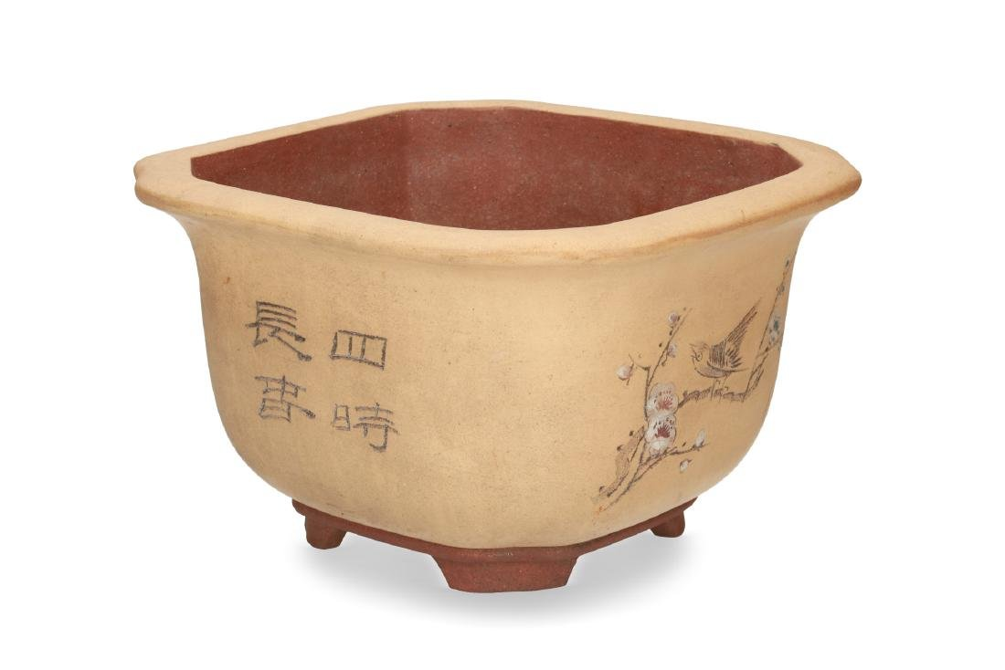 A square-shaped Yixing flower pot decorated with