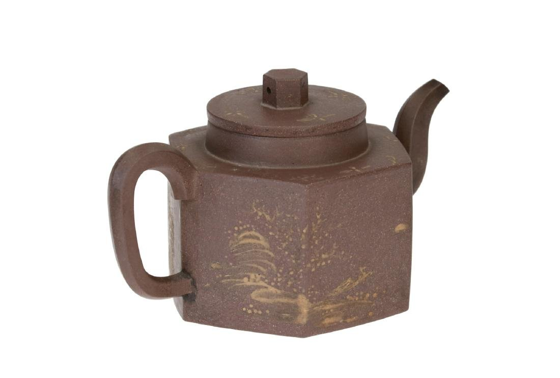 A hexagonal Yixing teapot, decorated with flowers and a