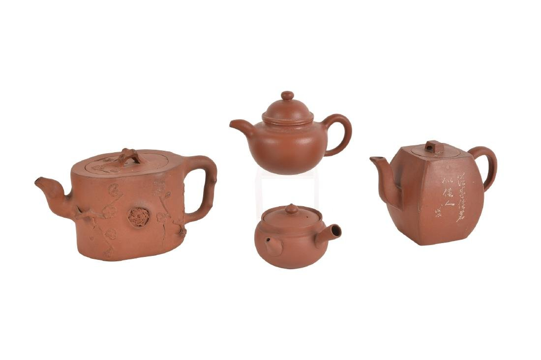 A lot of four various Yixing teapots. Three of them