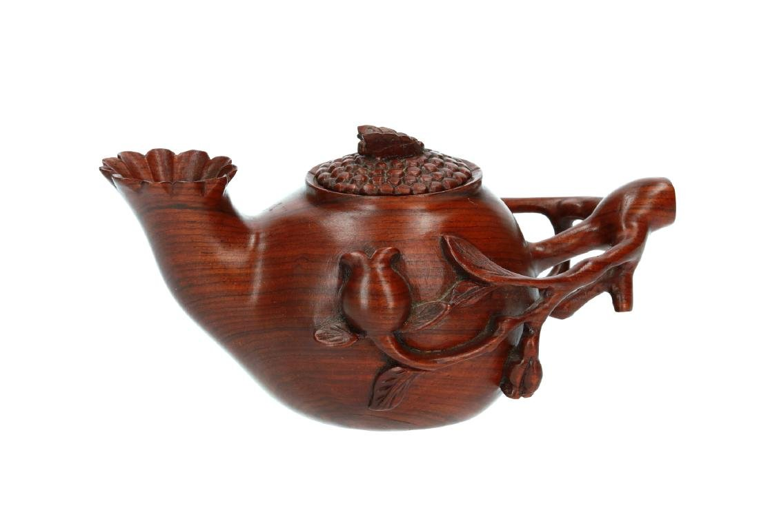 An openwork huanghali teapot with relief decor.
