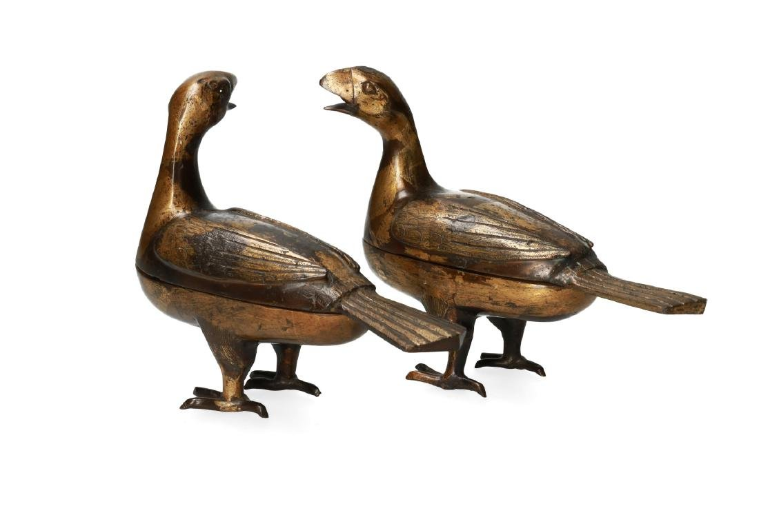 A pair of bronze perfume burners in the shape of birds.
