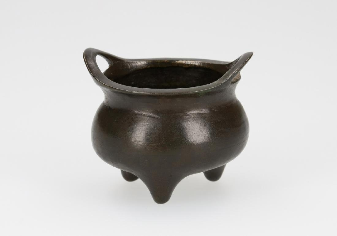 A bronze tripod censer with two handles. Marked with - 4