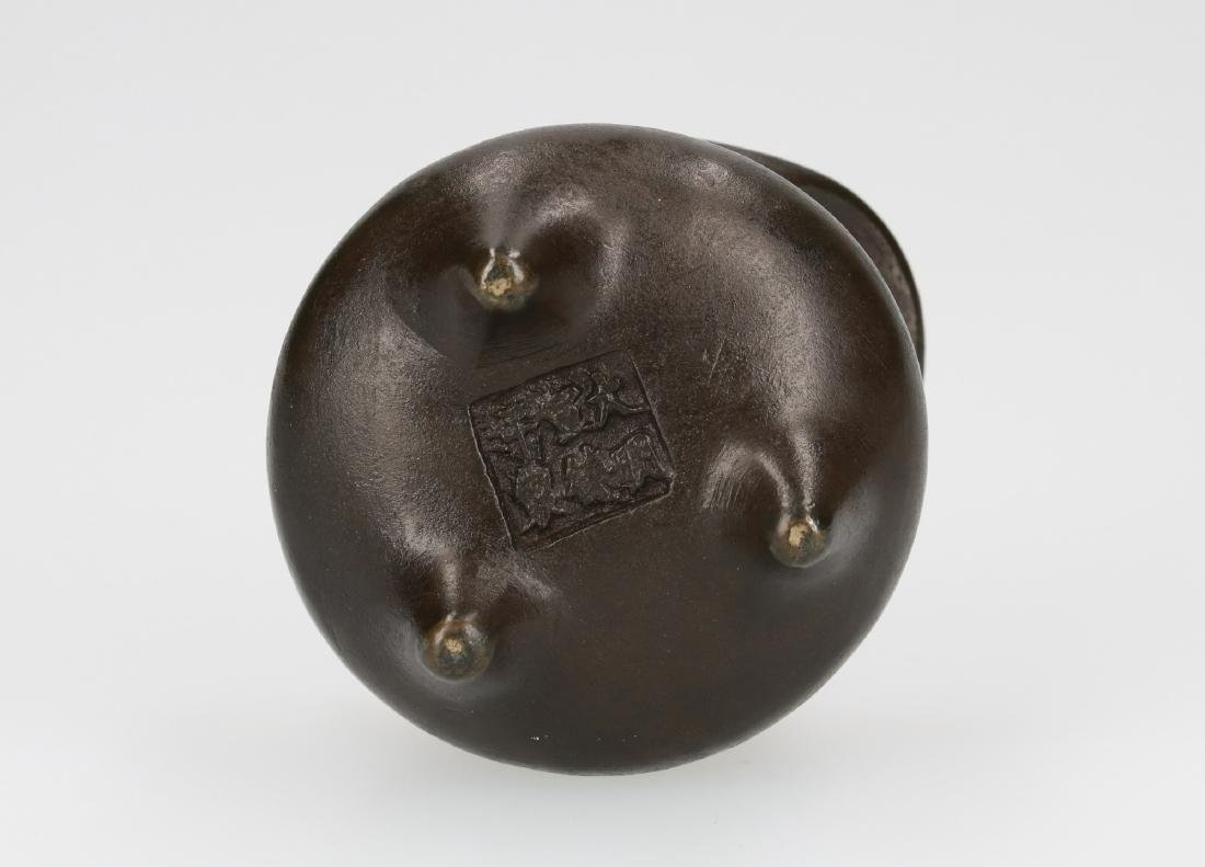 A bronze tripod censer with two handles. Marked with - 5