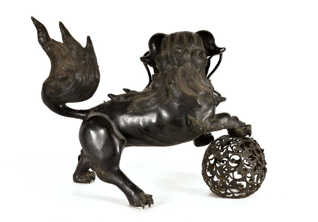 A bronze Fo-dog. China, 19th century. H. 57 cm. L. 75