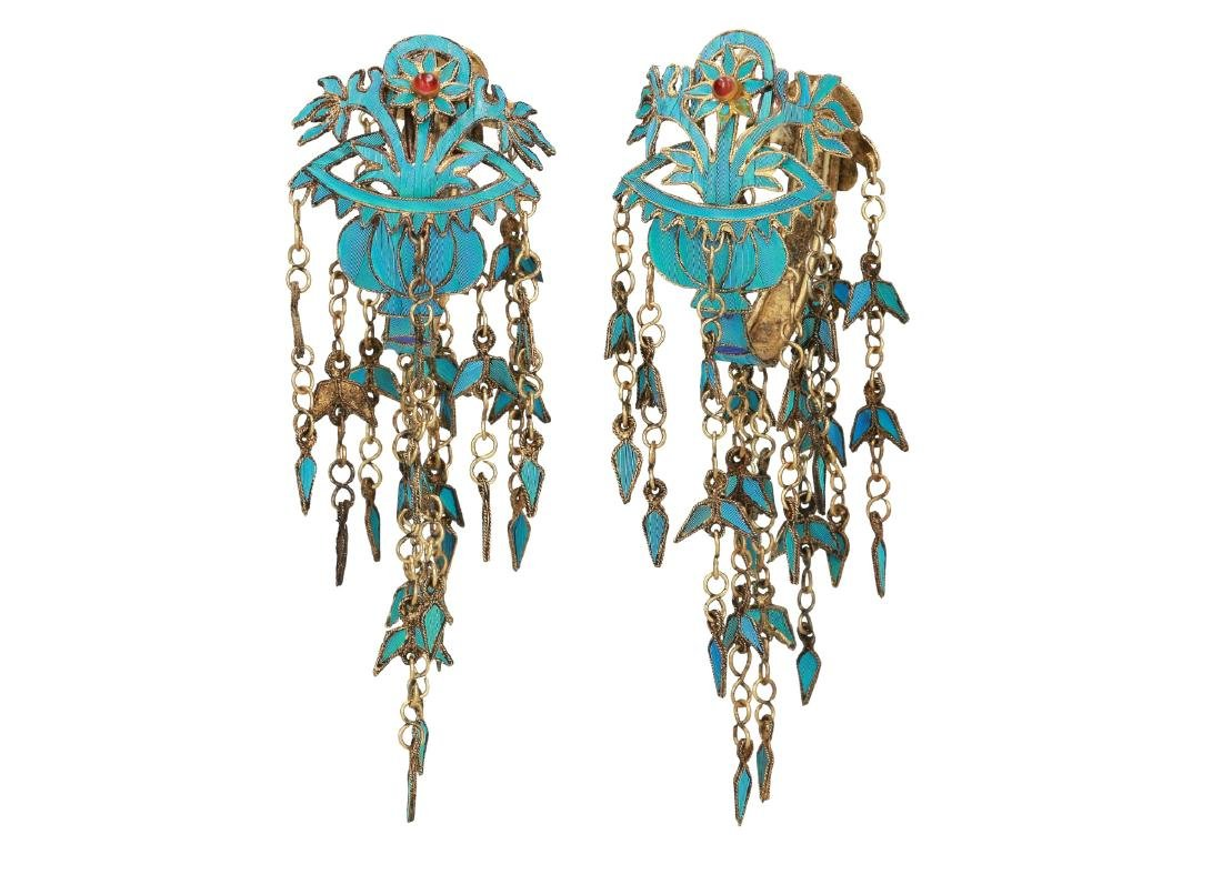 A pair of gilded earrings with kingfisher feathers and