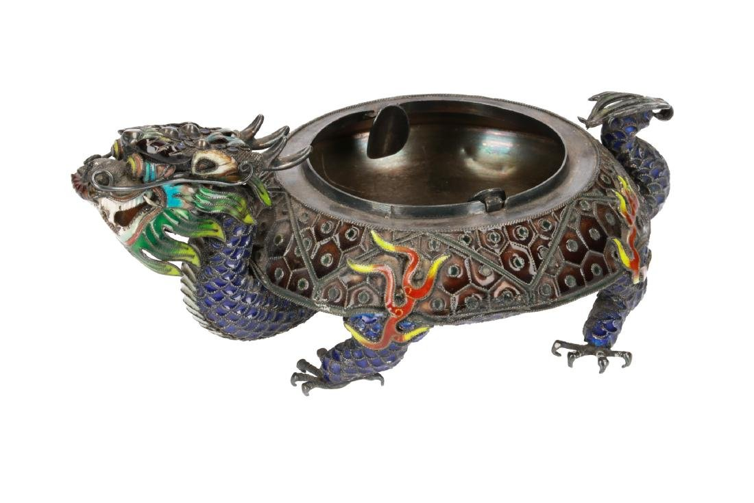 A silver dragon-shaped ash tray, decorated with enamel.