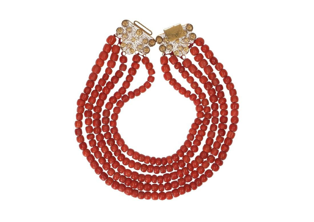 A five-strand red coral necklace with 18-kt gold clasp.