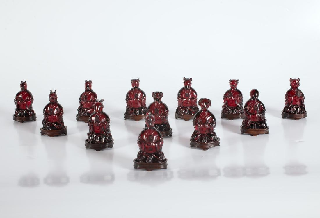 A set of 12 amber sculptures depicting the zodiac