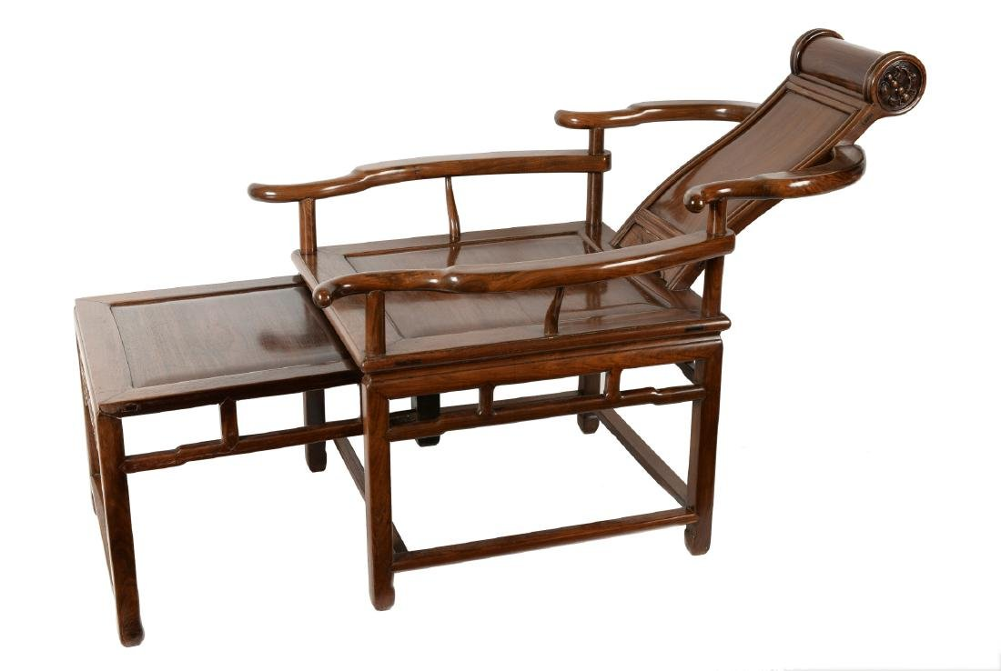 A Hongmu 'moongazing' chair with sliding foot rest.