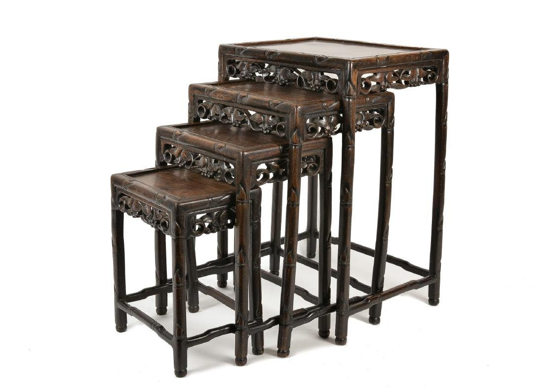 A set of four ironwood side tables. China, ca. 1900. H.