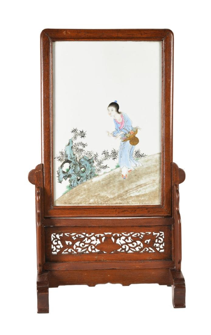 A polychrome porcelain table screen in wooden frame,