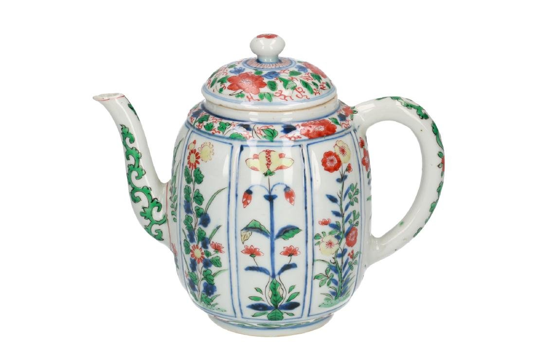 A Famille Verte porcelain wine jug with ribbed belly,