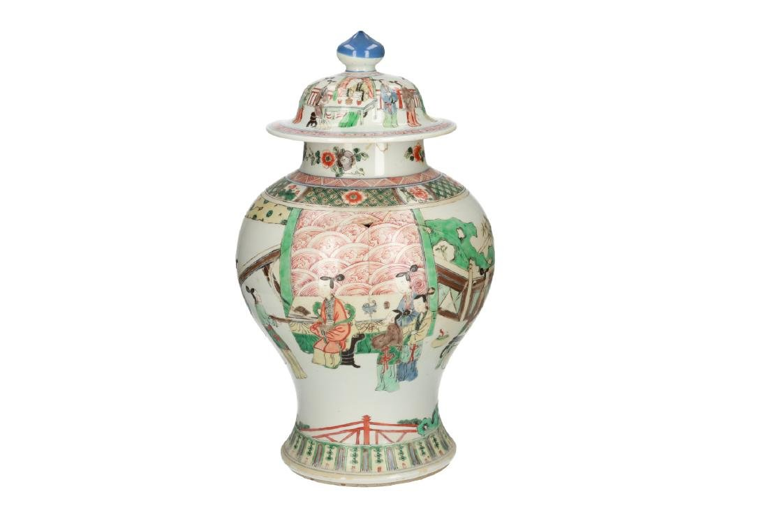 A pair of Famille Verte porcelain lidded baluster vases