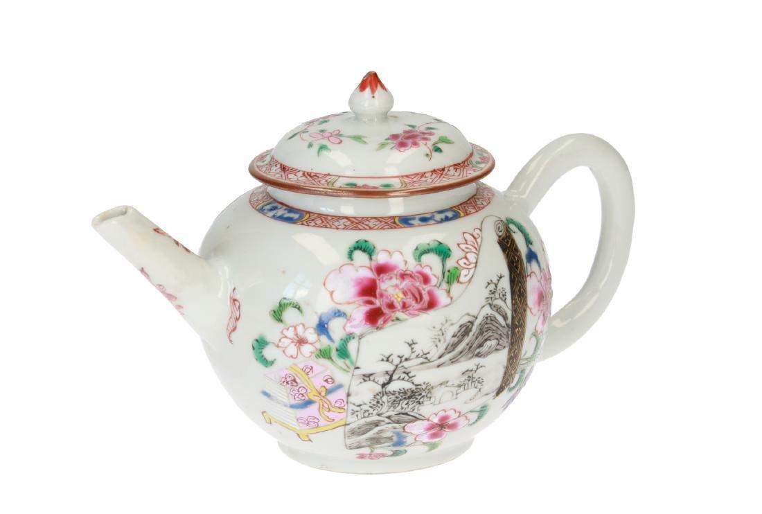 A Famille Rose porcelain teapot with floral decor.