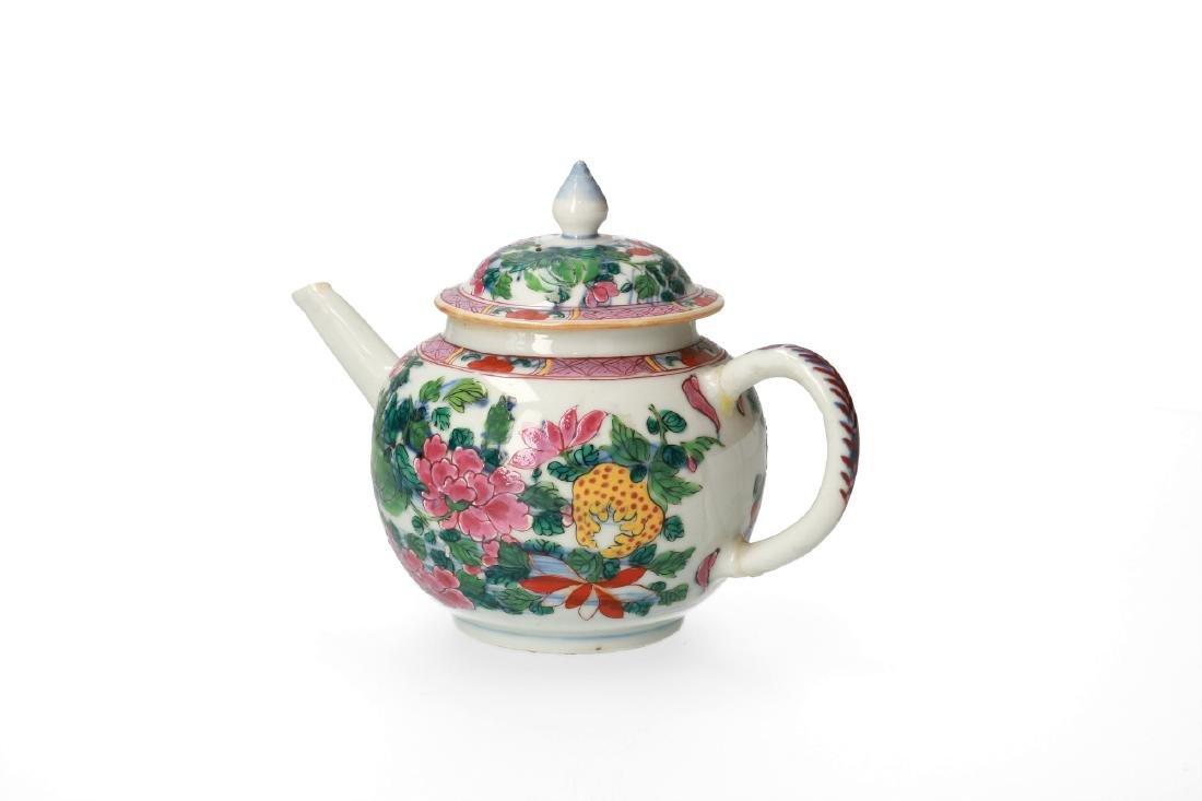 A polychrome porcelain teapot with floral decor.