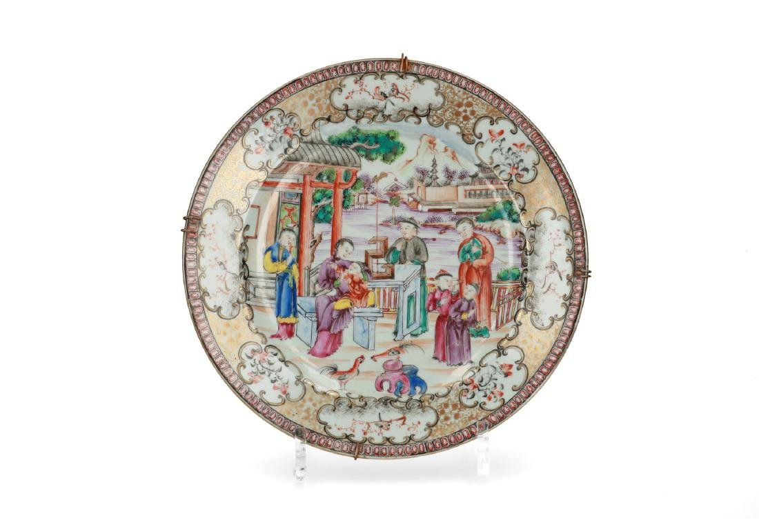 A polychrome porcelain export plate with a mountainous