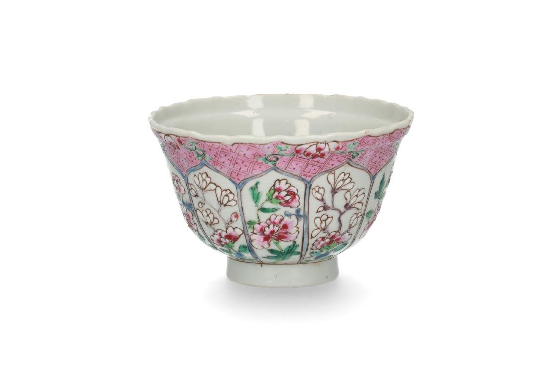 A Famille Rose porcelain bowl decorated with panels and