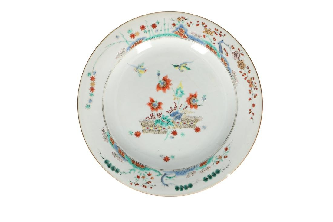 A pair of Kakiemon style dishes decorated with birds