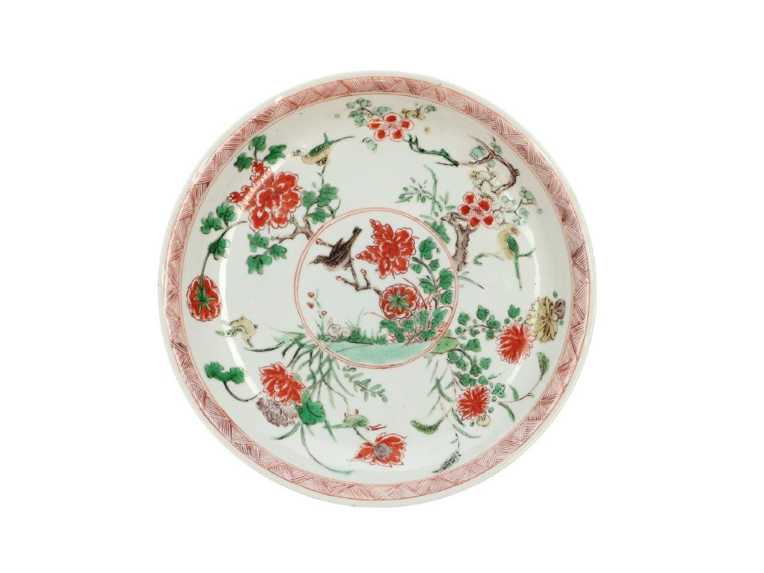 A Famille Verte porcelain deep dish decorated with