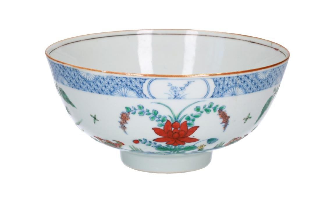 A doucai porcelain bowl, decorated with water birds and
