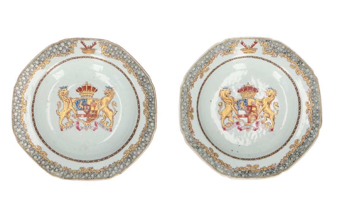 A pair of polychrome porcelain small saucers, decorated