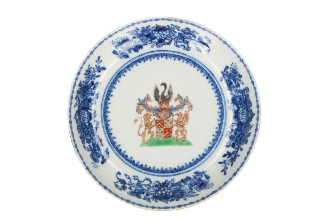 A blue and white armorial porcelain saucer for the