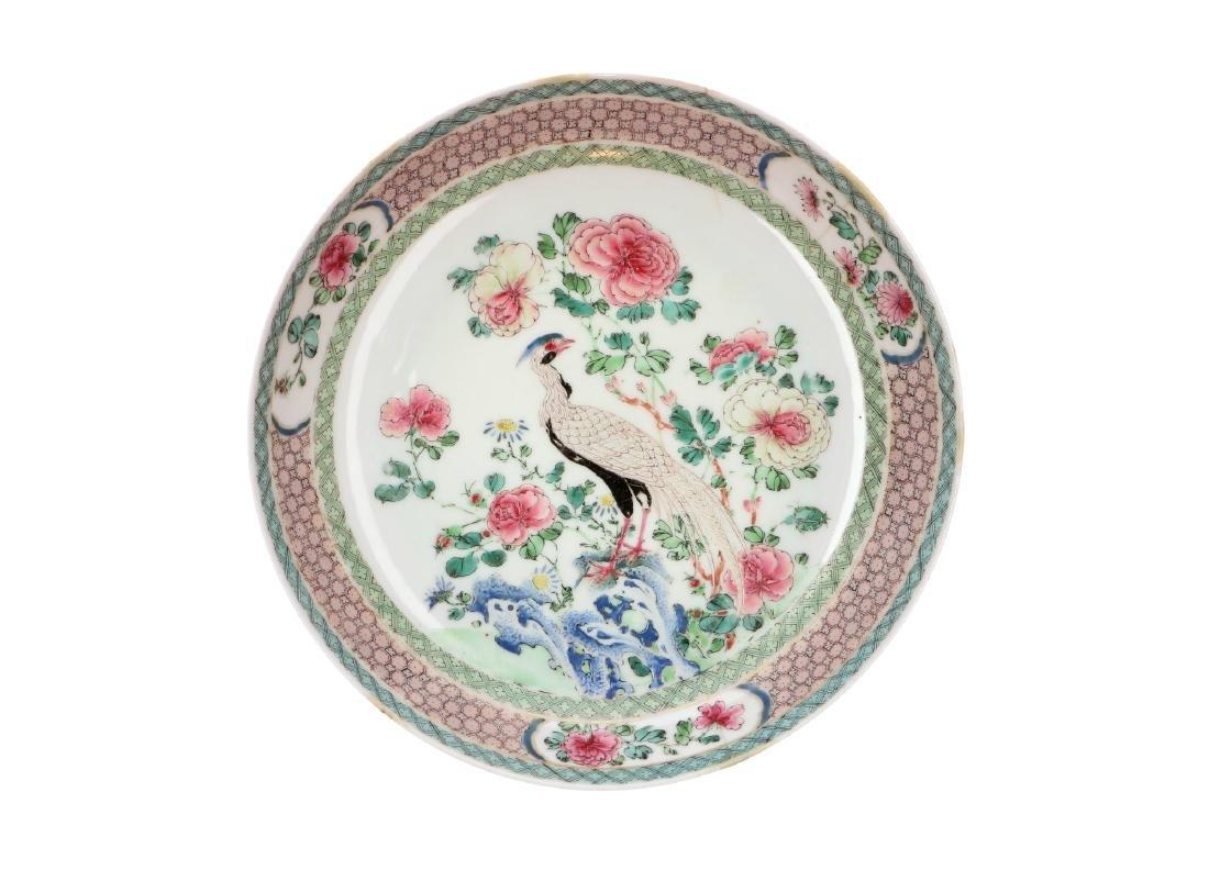 A polychrome porcelain deep dish decorated with a bird