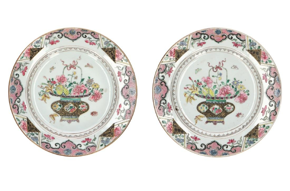 A pair of Famille Noir porcelain export dishes