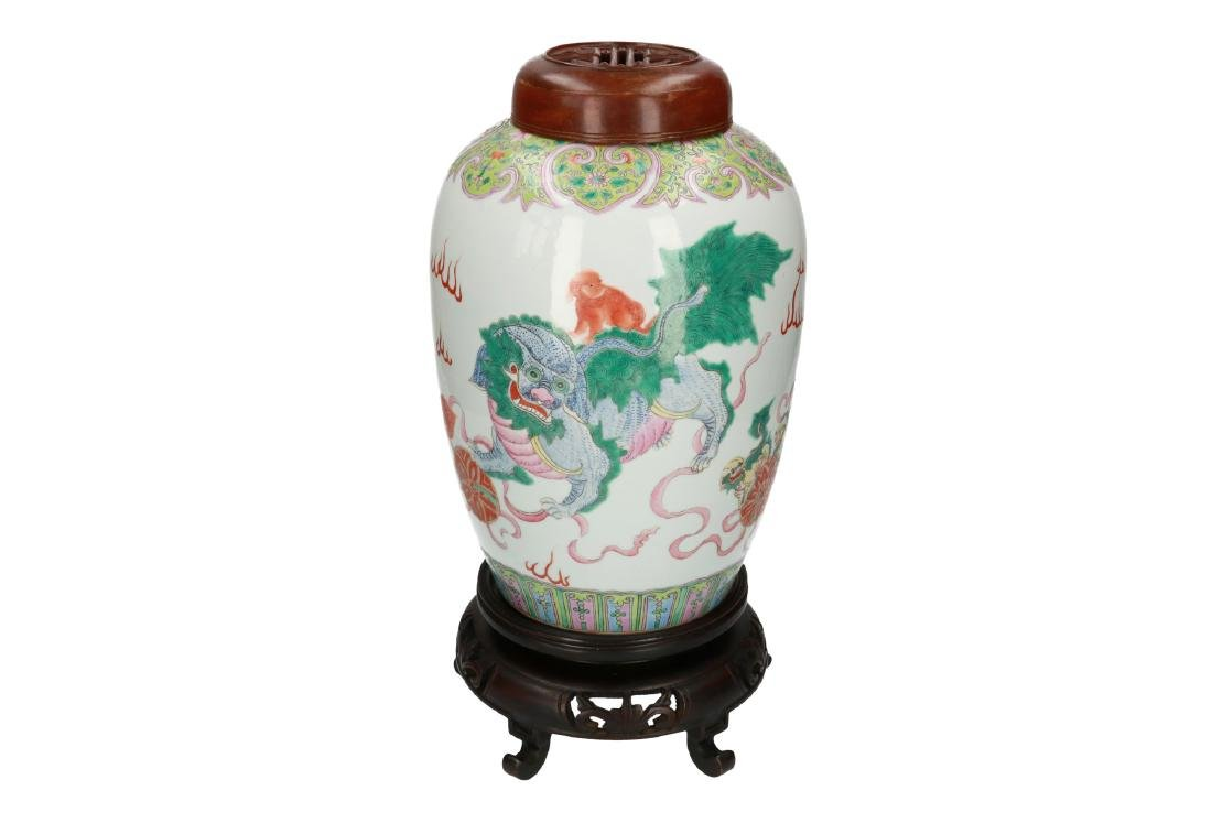 A polychrome porcelain vase, decorated with shishi with