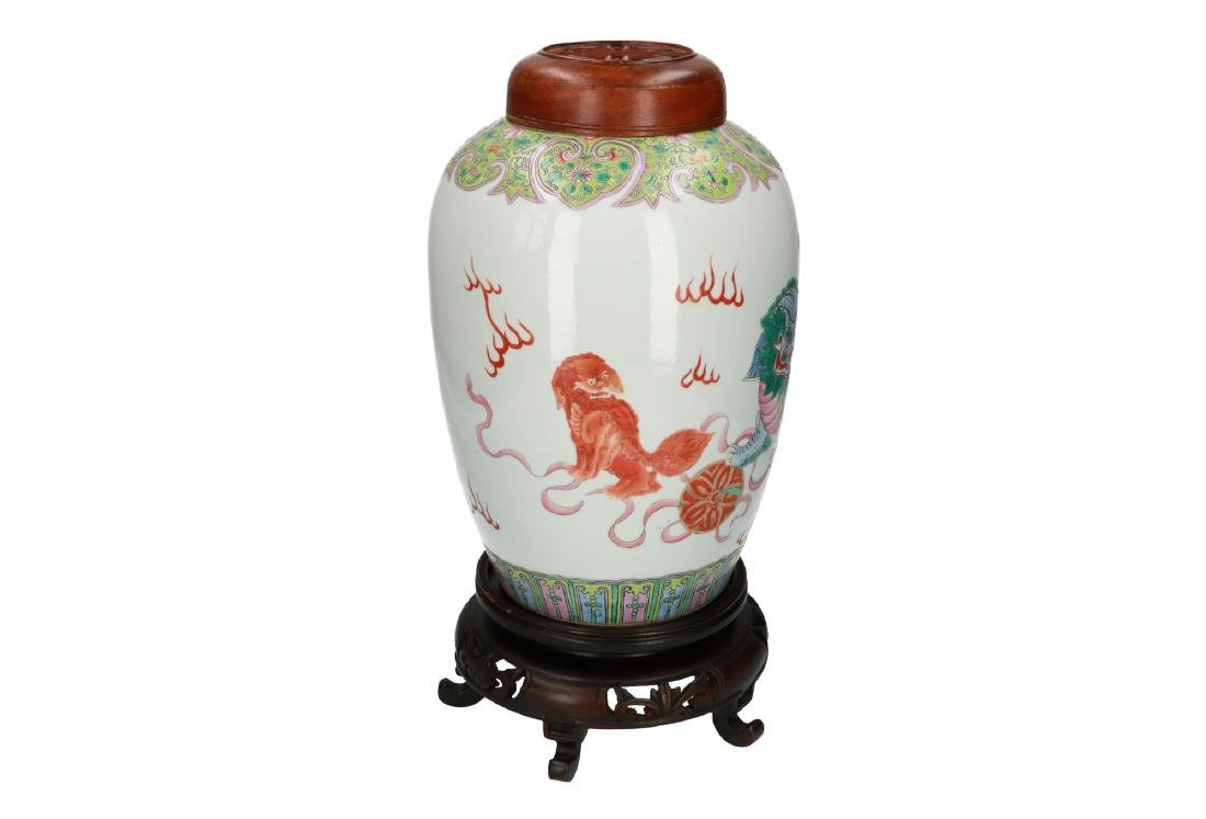 A polychrome porcelain vase, decorated with shishi with - 3