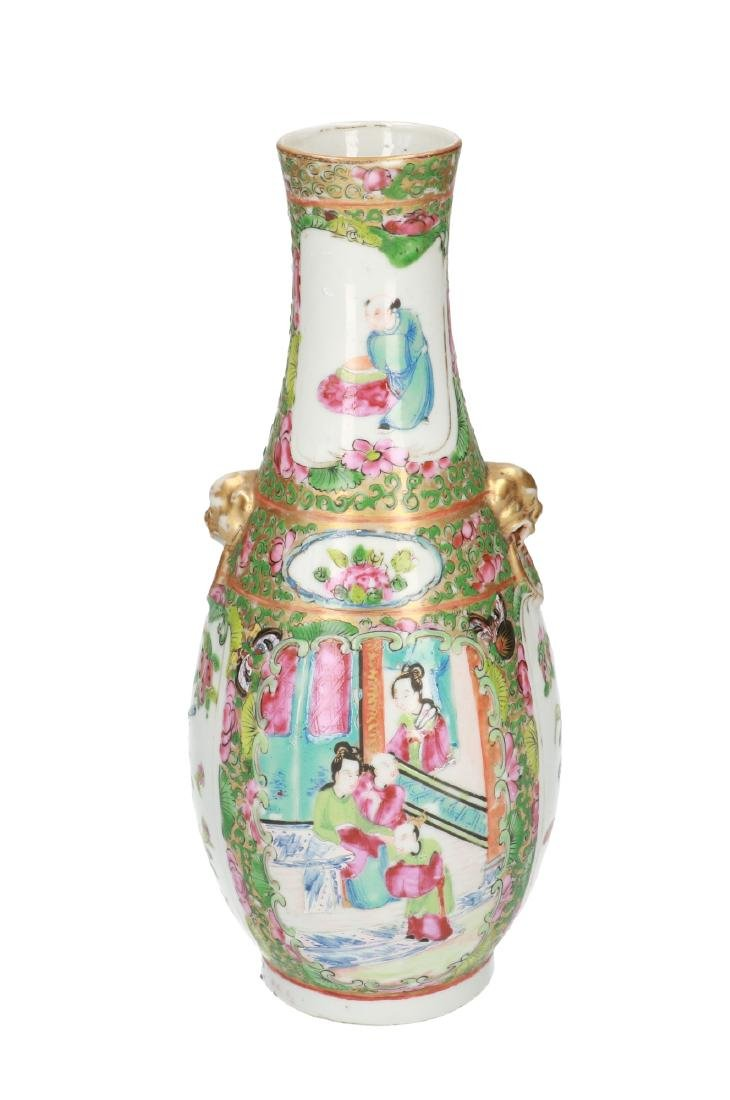 A polychrome porcelain vase, decorated with figures,