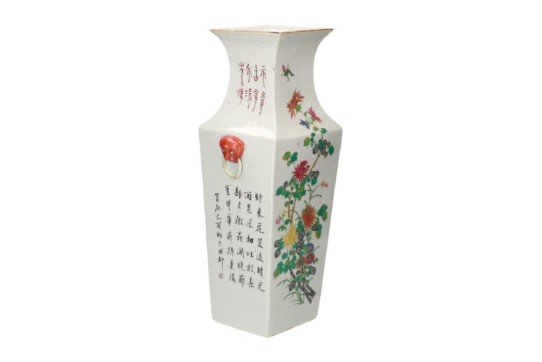 A polychrome porcelain square vase with floral decor