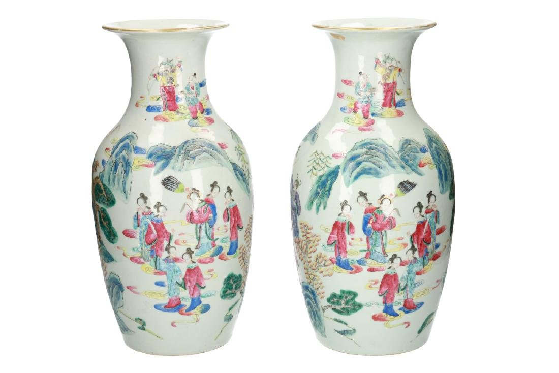 A pair of polychrome porcelain vases decorated with