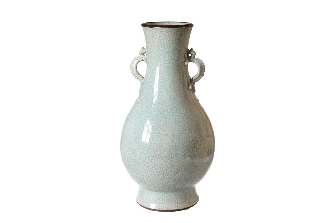 A green glazed porcelain vase with craquelé decor and