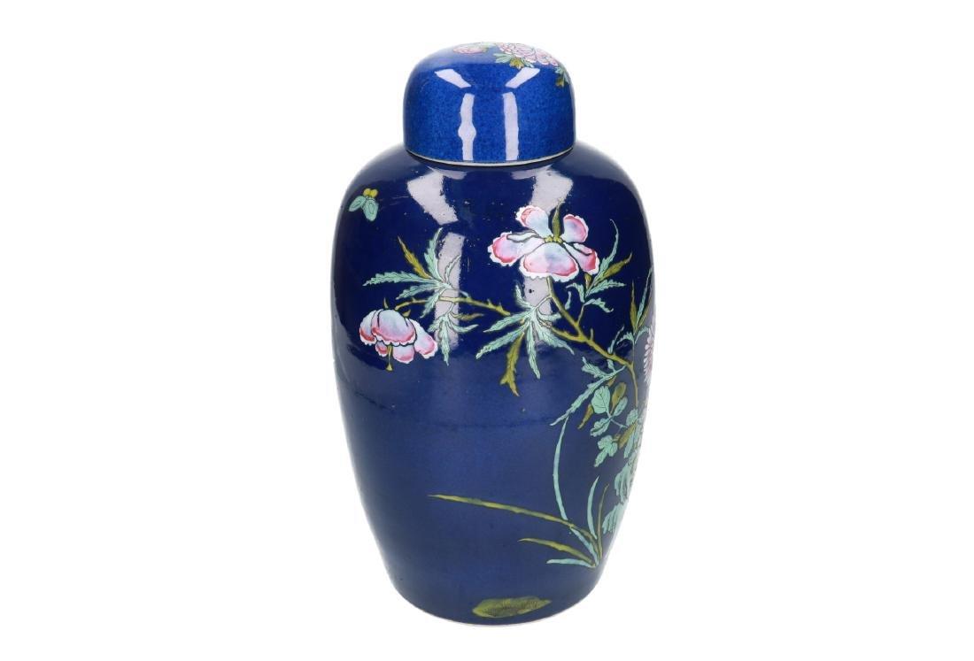 A powder-blue lidded vase with polychrome floral decor. - 3