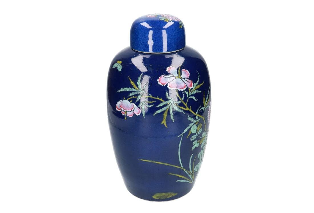 A powder-blue lidded vase with polychrome floral decor. - 3