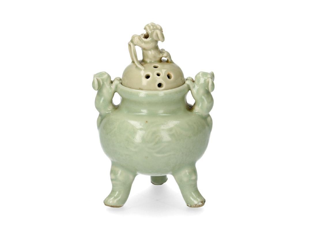 A porcelain celadon tripod insence burner. Handles and