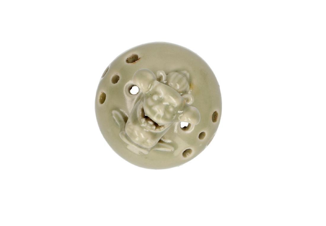 A porcelain celadon tripod insence burner. Handles and - 5