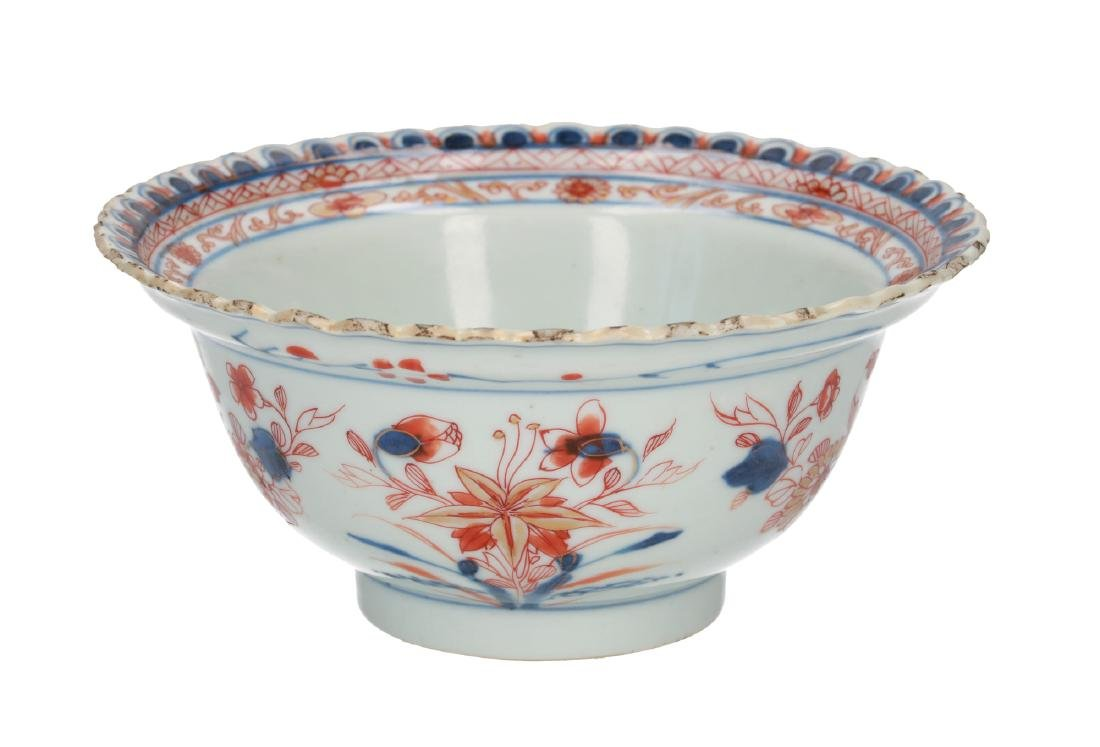 A pair of polychrome porcelain bowls with floral decor.