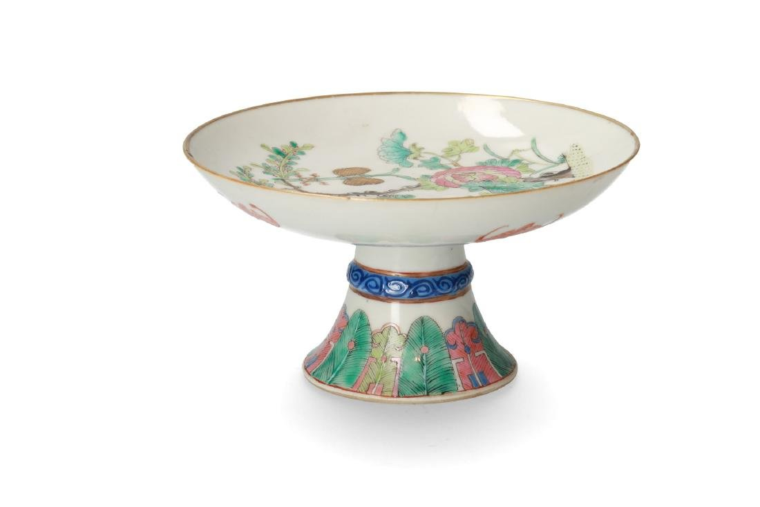 A polychrome porcelain tazza decorated with flowers and