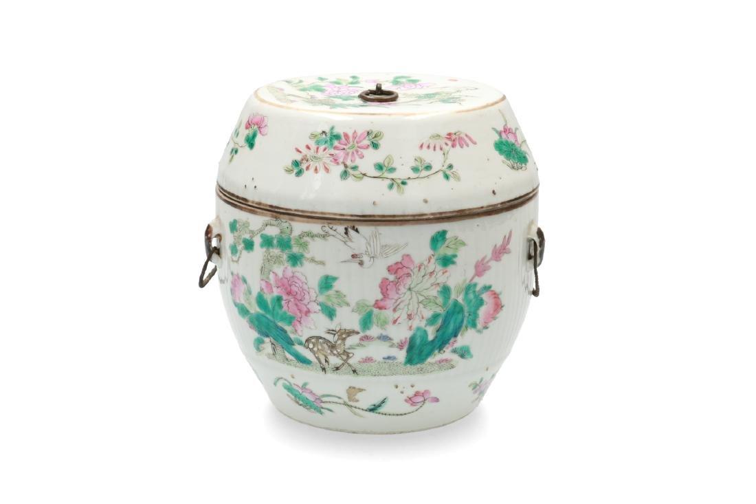 A polychrome porcelain lidded jar decorated with deer,