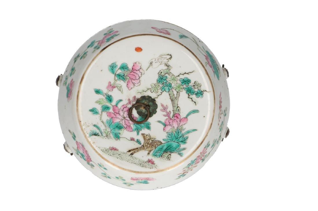 A polychrome porcelain lidded jar decorated with deer, - 6