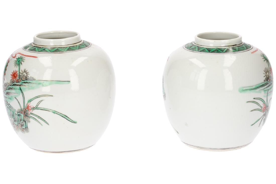 A pair of Famille Verte porcelain ginger jars,