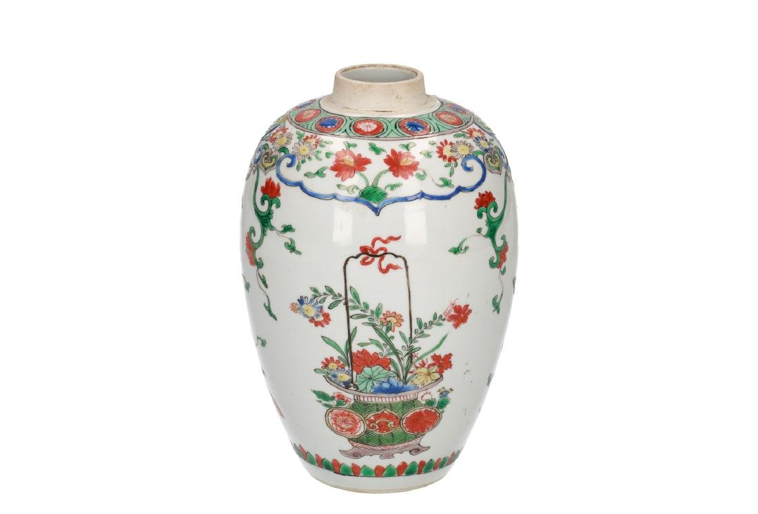 A Famille Verte porcelain lidded vase decorated with