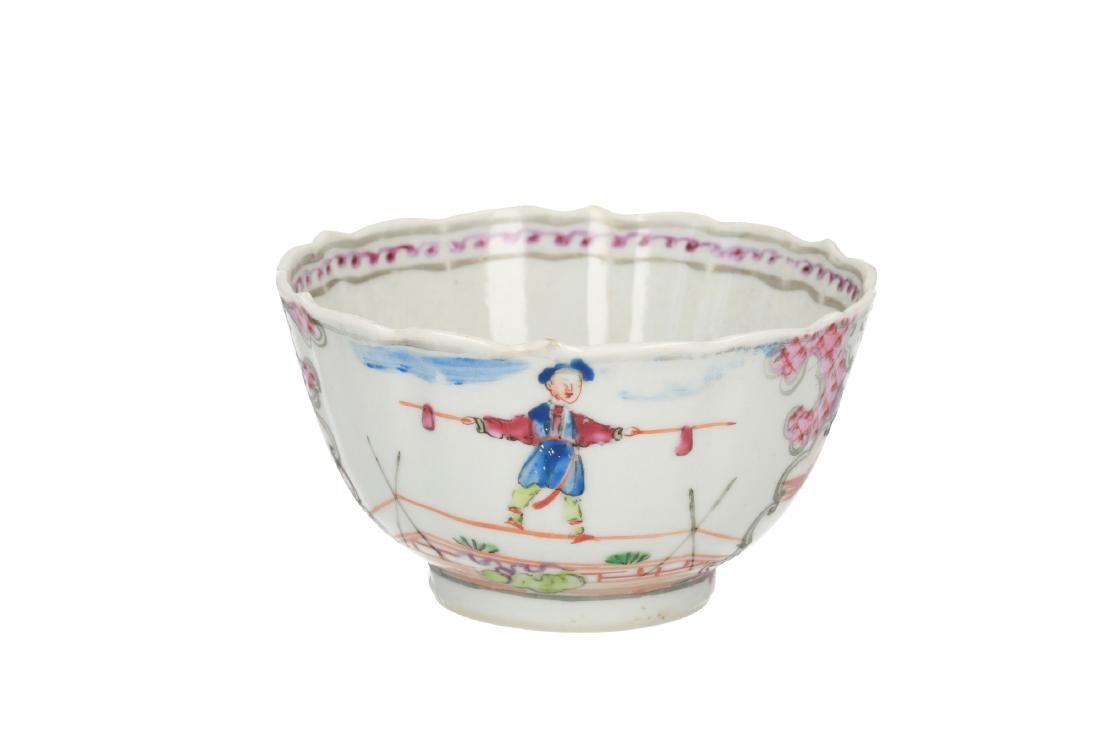 A polychrome porcelain cup with saucer, decorated with