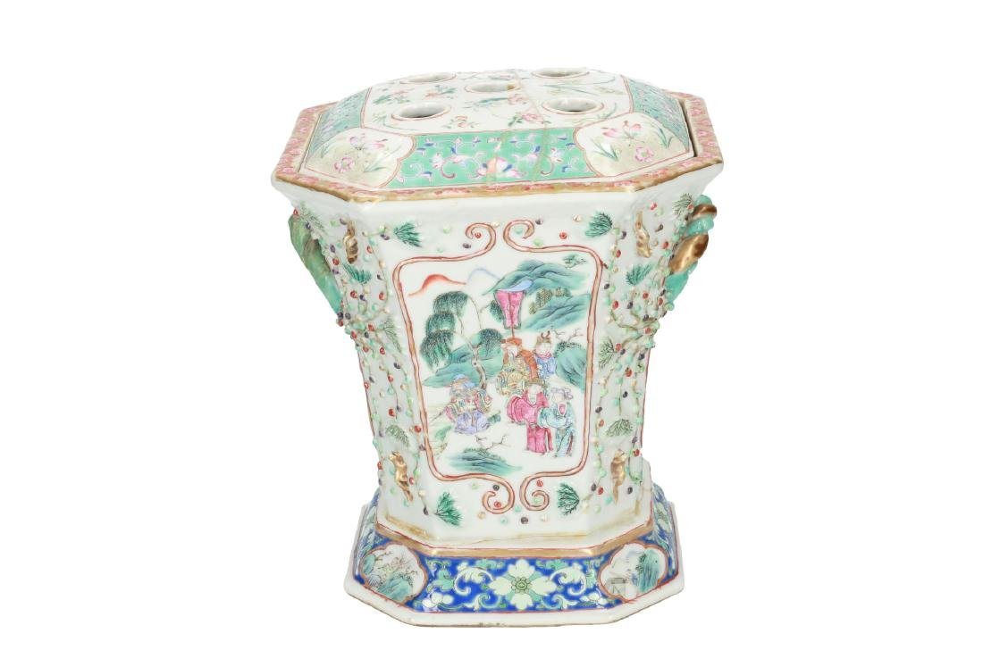 A polychrome porcelain octagonal insence burner with a