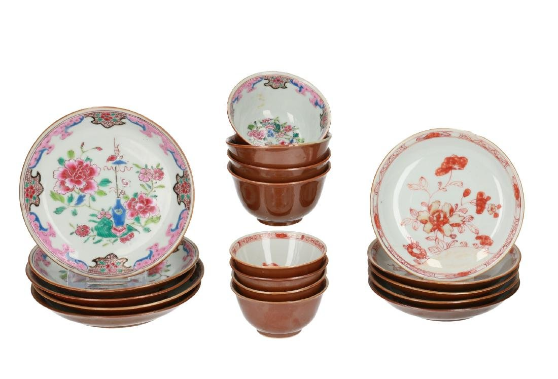 A polychrome porcelain set of four cups with five